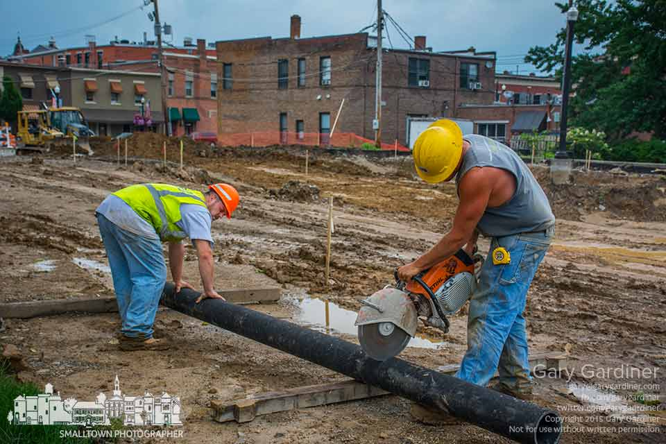 Decker Construction workers cut a section of water pipe that connects to a new hydrant that replaces another hydrant being removed during renovation and expansion of the parking lot behind city hall. My Final Photo for June 30, 2015