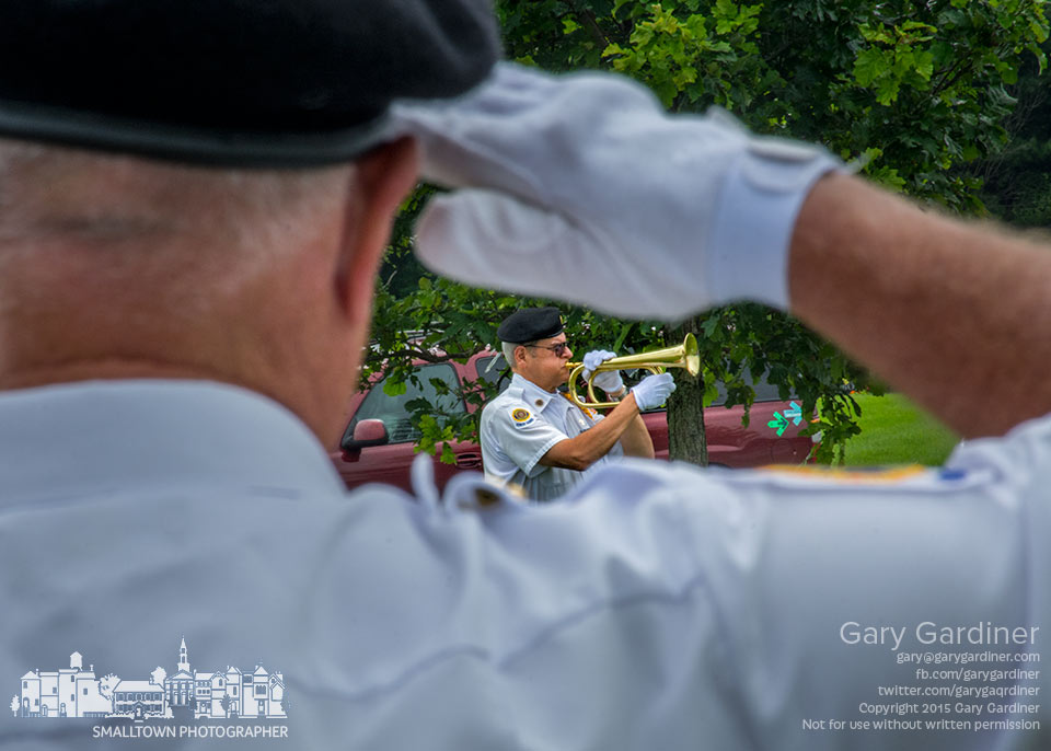 """A bugler plays """"Taps"""" following a 21-gun salute at the funeral for Marine veteran John B. Tuller during ceremonies at Blendon Township Cemetery. My Final Photo for July 9, 2015."""