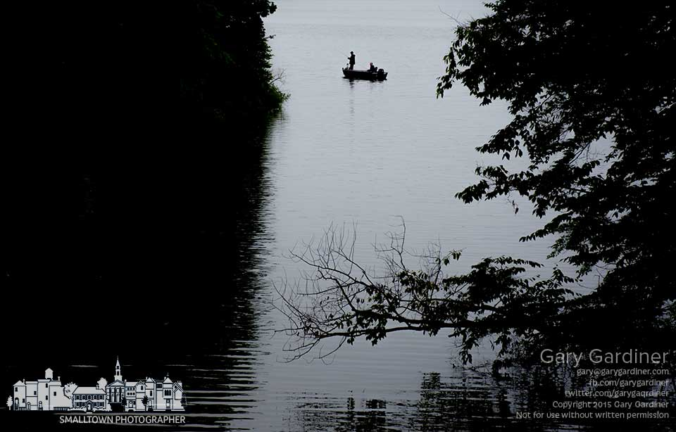 A fisherman navigates along the northern shore of Hoover Reservoir in a light rain on Friday before a holiday. My Final Photo for July 3, 2015.
