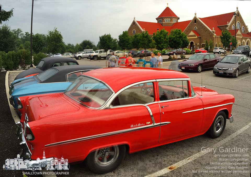 A trio of vintage cars park in the edge of the lot for the first Mass of the day at St. Paul Catholic Church on Good Guys car show weekend. My Final Photo for July 12, 2015.