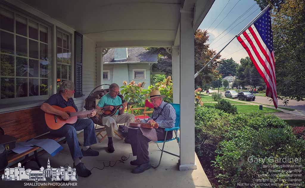 A trio plays traditional country music on the porch of one of the homes open to visitors as part of the tapestry of a Town historical tour in Uptown Westerville. My Final Photo for July 26, 2015.