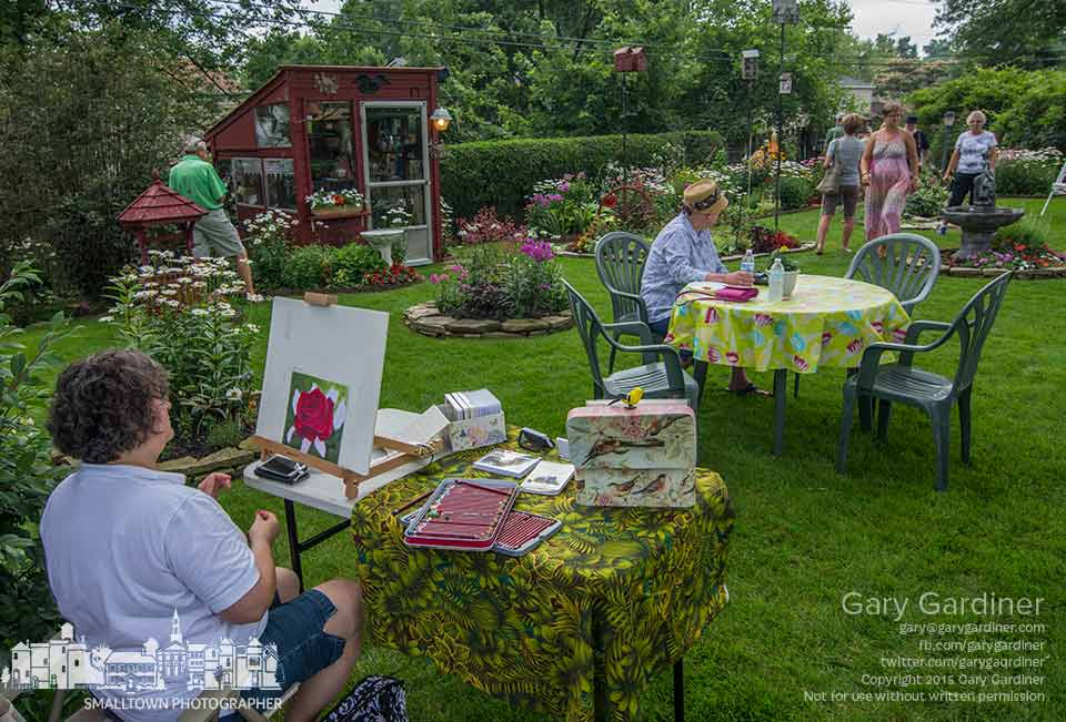 An artist paints at the edge of one of the gardens featured in Westerflora, the annual tour of gardens in the Westerville area. My Final Photo for July 19, 2015.