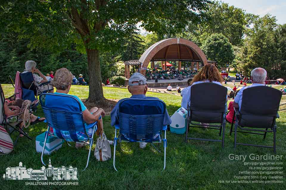 Music lovers sit in the shade of a tree at the top of the hill at the Alum Creek amphitheater during a daylong concert by community bands. My Final Photo for Aug. 8, 2015.