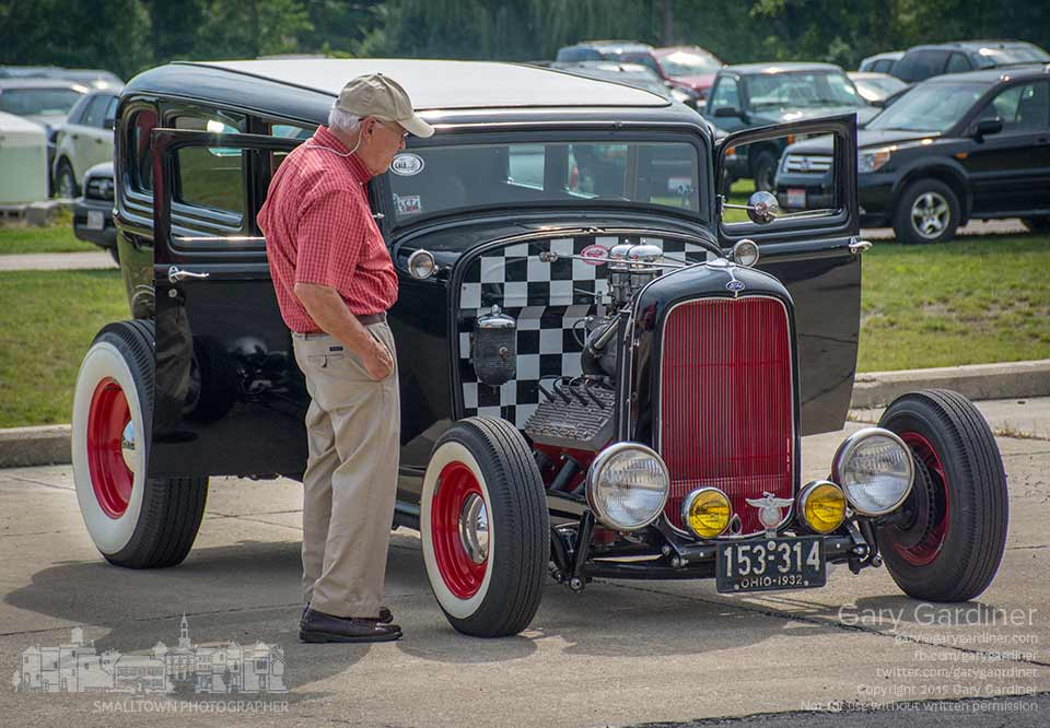 A man studies the engine on one of the vintage cars and hot rods on display at the Blendon Township Car Show Saturday. My Final Photo for Aug. 29, 2015.