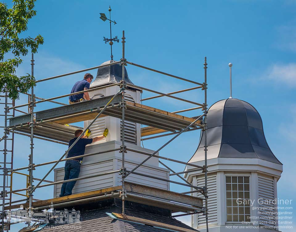 Workers install panels to the cupola at the peak of the original section of city hall replacing old sections after repairs for leaks. My Final Photo for Aug.  14, 2015.