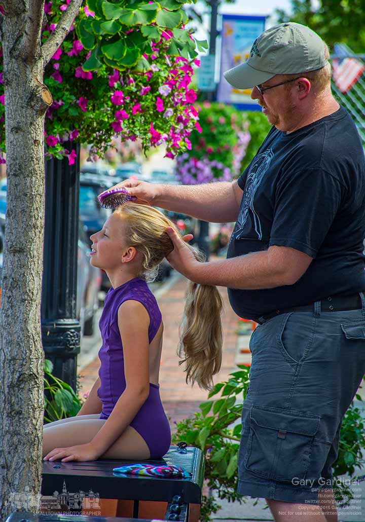 Eight-year-old Elle smiles as her father, Andrew Shroads,  combs her hair before putting it into a dancer's bun for her dance class at Generations Performing Arts Center in Uptown Westerville. My Final Photo for Aug. 20, 2015.