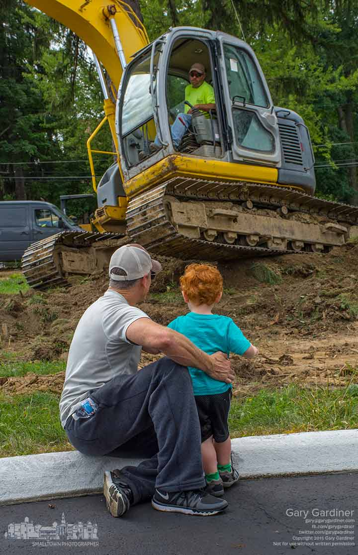 Grandfather and grandson watch heavy equipment moving dirt at the site of Northstar Cafe in Uptown Westerville where the early stages of construction began this week. My Final Photo for Aug. 27, 2015.