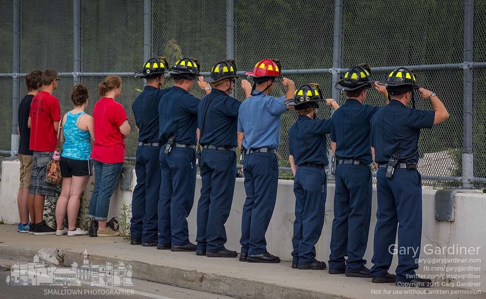 Westerville fire fighters salute the families of Lima Company as they pass under the Dempsey Road bridge on their way to a ceremony at Rickenbacker honoring the Marines who died in combat in Iraq. My Final Photo for Aug. 15, 2015.