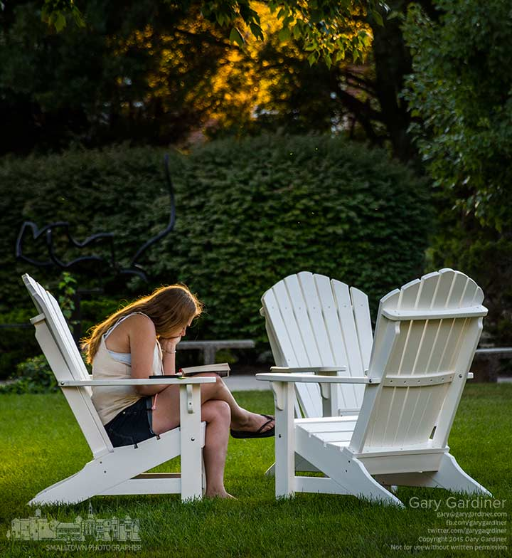 An Otterbein student studies sitting in one of the chairs the school placed around campus for use by students. My Final Photo for Aug. 24, 2015.