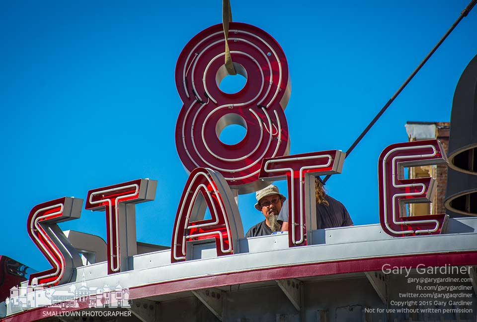 Workers prepare to bolt into place the neon number 8 atop the marquee at the old State Theater where 8 State Bistro plans to open in November. My Final Photo for Sept. 24, 2015,.