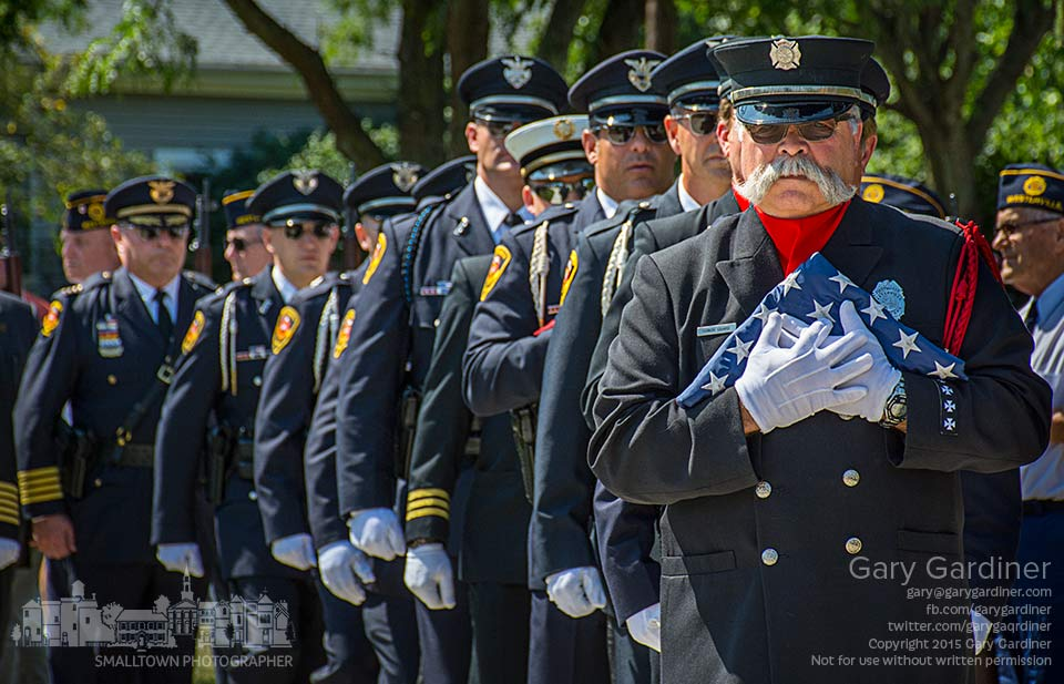 Retired Westerville fire fighter Tom Ullom leads a portion of the city honor guard at the start of ceremonies at First Responder Park marking the anniversary of the terrorist attacks on the World trade Center in New York. My Final Photo for Sept. 11, 2015.
