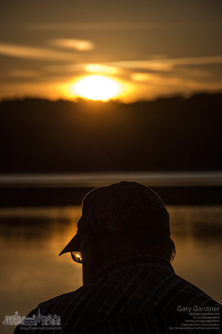 An angler prepares his tackle for a day of  fishing as the sun rises on Hoover Reservoir. My Final Photo for Sept. 14, 2015.