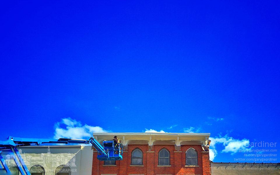 Painters work under a nearly clear late summer sky to finish renovation on the cornice of a building on North State Street in Uptown Westerville. My Final Photo for Sept. 20, 2015.