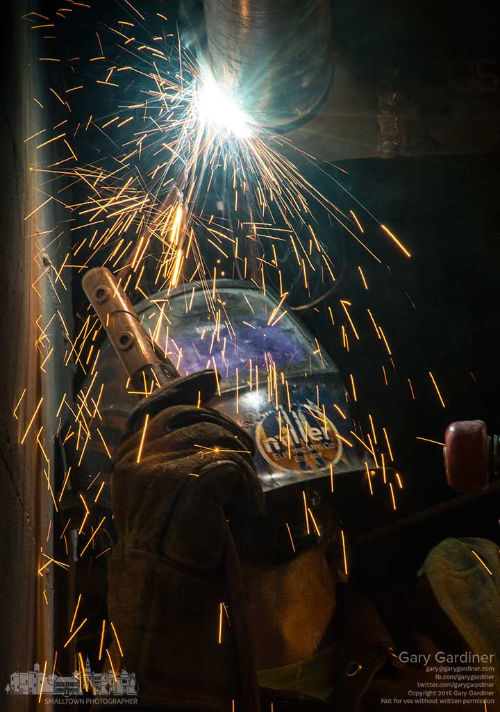 A welder joins sections of steel pipe for a new natural gas feed to Asterisk Supper Club in Uptown Westerville. My Final Photo for Sept. 16, 2015.
