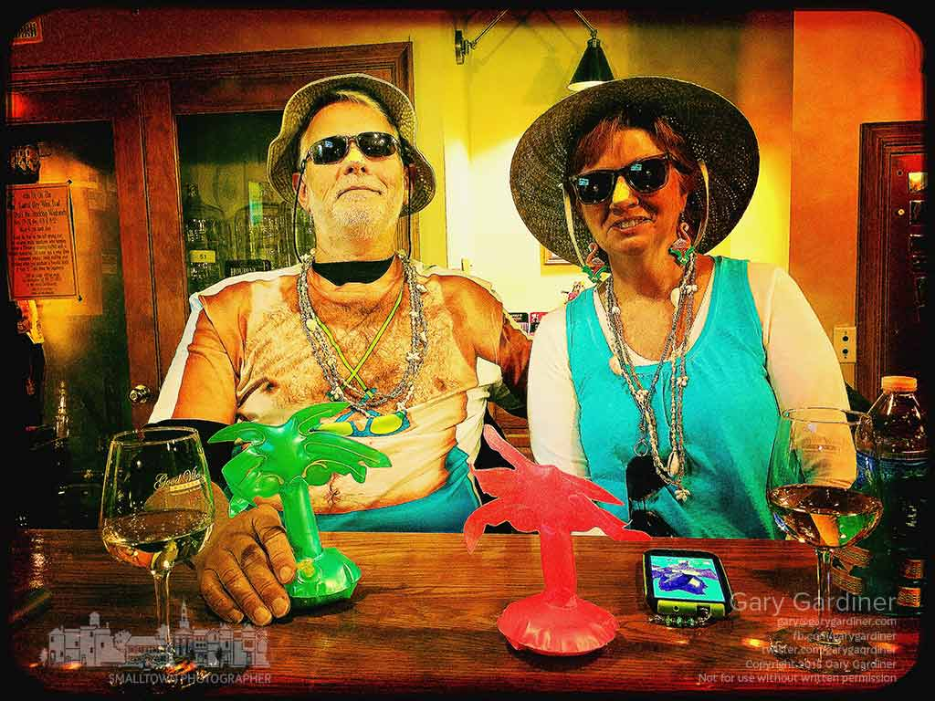 A costumed couple who brought their own party favors sit at the bar inside Good Vibes in Uptown as the winery's annual night before Halloween party begins. My Final Photo for Oct. 31, 2015.
