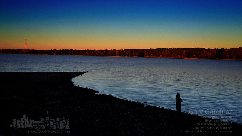 A lone fisherman stands on the shoreline in early evening near the old Walnut Street roadway now covered with Hoover Reservoir. My Final Photo for Oct. 18, 2015.