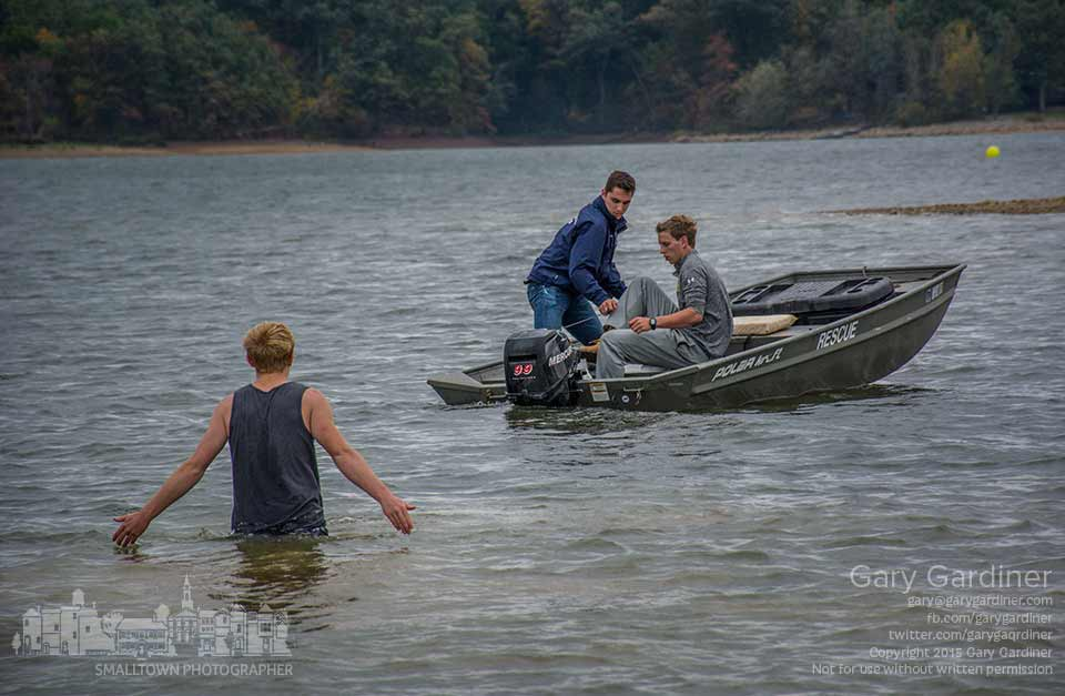 A pair of boaters try to removed themselves from a sandbar in Hoover Reservoir as a helper wades to their aid during setup for the Columbus Fall Classic rowing competition on Saturday. My Final Photo for Oct. 9, 2015.