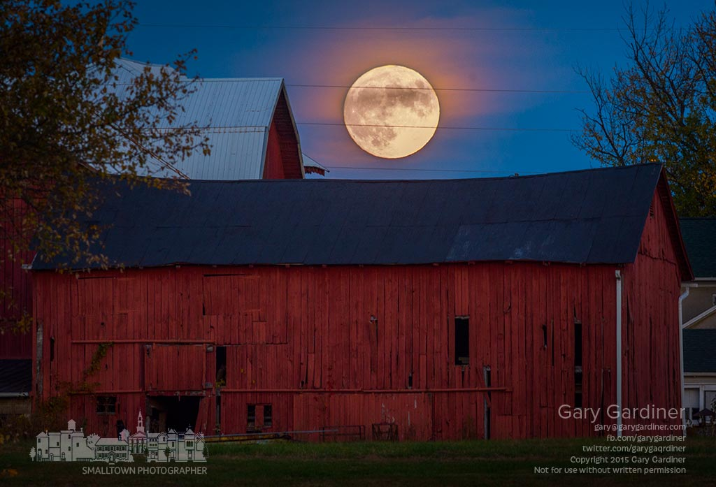 The start of a full moon rises over the Yarnell Farms barn beginning its overnight journey to an early morning perigee marking the hunter's moon's brightest moment. My Final Photo for Oct. 26, 2015.