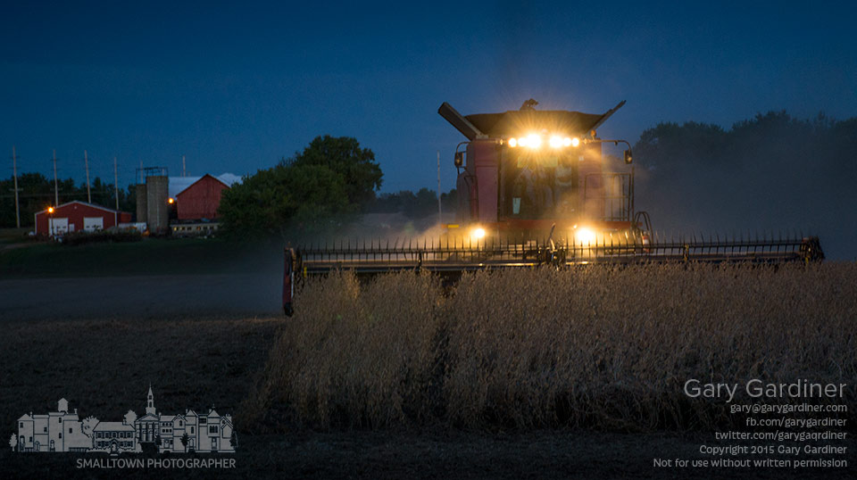 Francis McNamara runs his combine after  sunset  through the final rows of soybeans on fields he leases from the Yarnell family in Westerville. My Final Photo for Oct. 5, 2015.