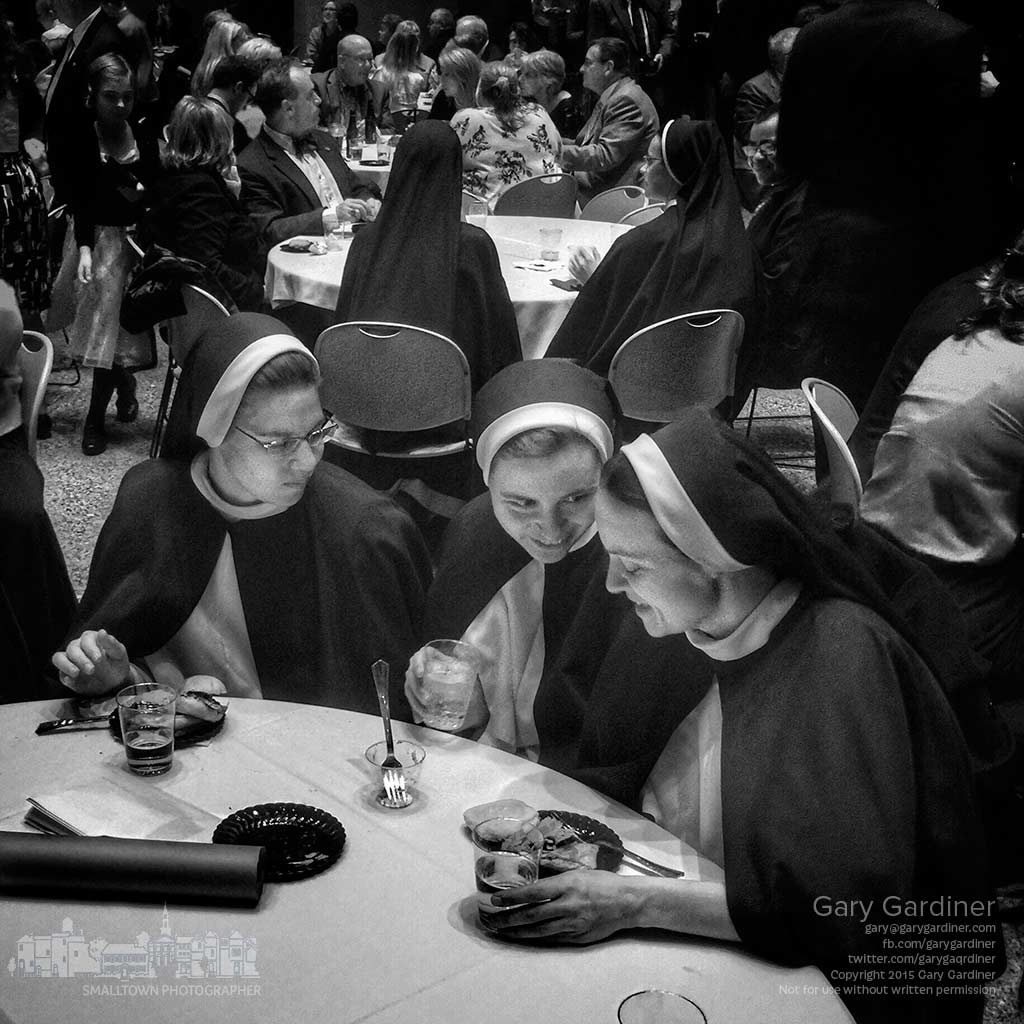 A trio of Dominican nuns attending the 800th Jubilee of the founding of their order talk quietly after a meal following the celebratory Mass. My Final Photo for Nov. 14, 2015.