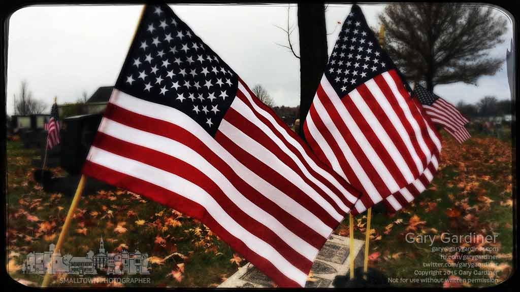 A row of flags mark the graves of veterans buried at Blendon Township Cemetery where the flags are replaced each year by Boy Scouts. My Final Photo for Nov. 10, 2015.