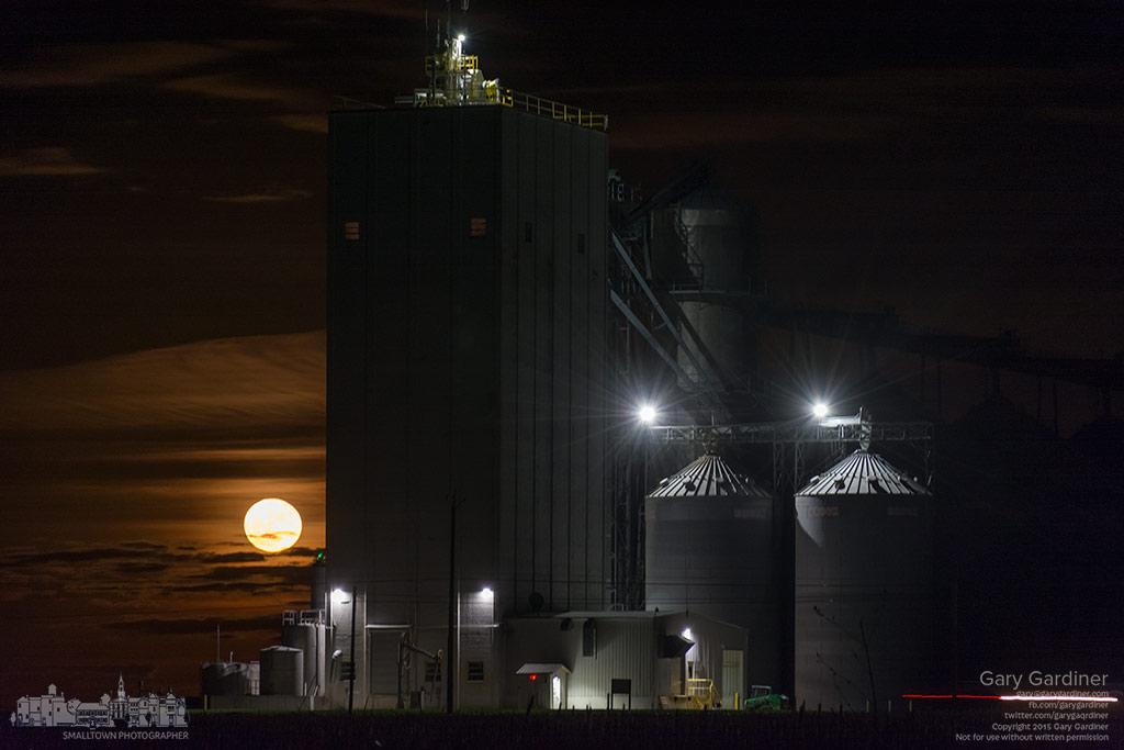 The moon rises bright behind a grain elevator near egg farms in Croton, Ohio. My Final Photo for Nov. 26, 2015.