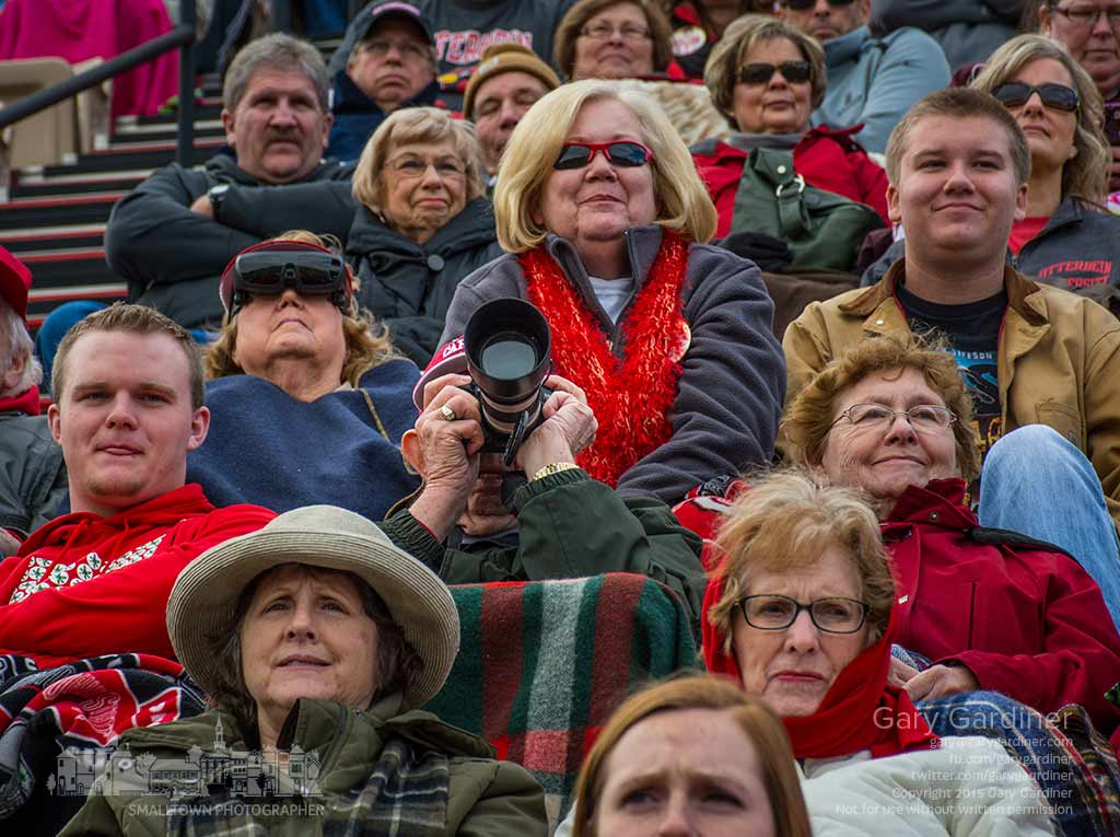 Westerville photographer Roger Howard surveys the Otterbein football field through his camera as the other fans around him watch the end of the first half. My Final Photo for Nov. 7, 2015.