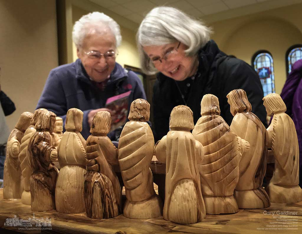 Two St. Paul Catholic Church parishioners examine one of the olive wood Nativity sets displayed at the church after Mass before deciding which one they might buy. My Final Photo for Nov. 29, 2015.