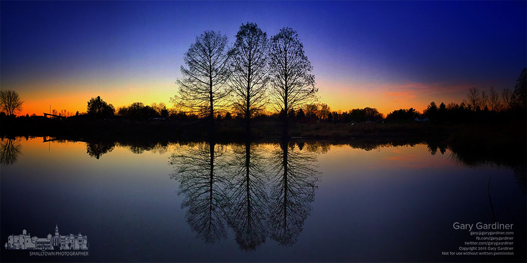 A clear sky sunset creates a perfect silhouette of three cypress trees growing along the edge of the wetlands at Highlands Park. My Final Photo for Nov. 15, 2015.