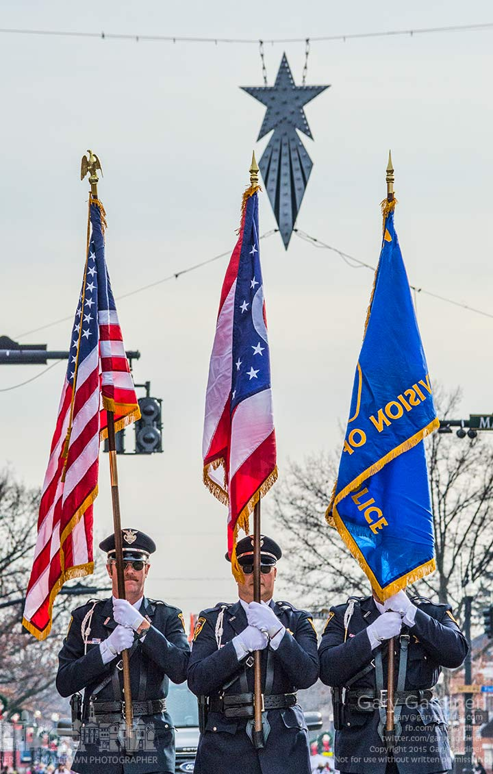 The Westerville Police Honor Guard leads the Christmas parade beneath the Christmas Star hanging at State and Main. My Final Photo for Dec. 6, 2015.