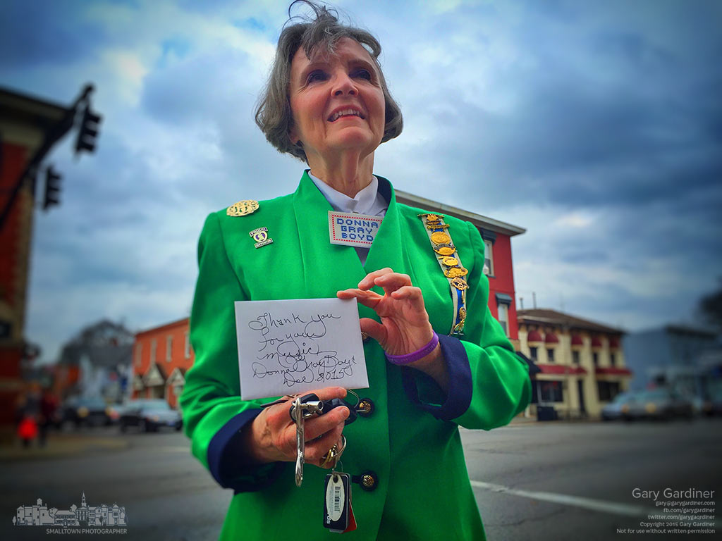 DAR member Donna Gray Boyd holds a thank you card she presented to carolers after their performance on the sidewalks in Uptown Westerville. My Final Photo for Dec. 12, 2015.
