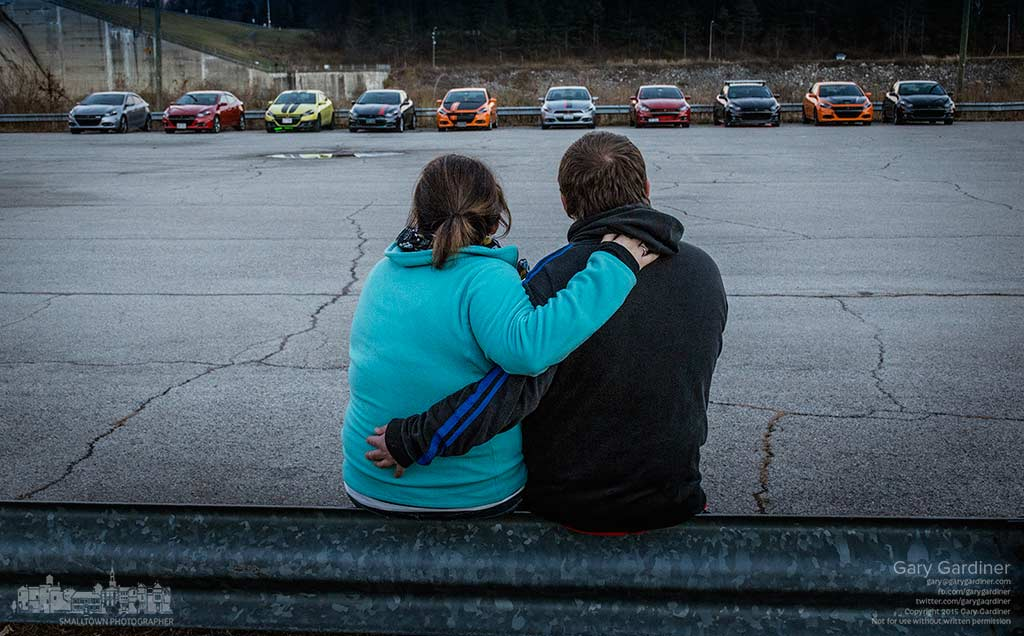 A couple sits on the guardrail of a parking lot at Hoover Dam across the lot from the Dart Club of Columbus gathering after a fundraiser for the US Marines Toys for tots drive. My Final Photo for Dec. 5, 2015.