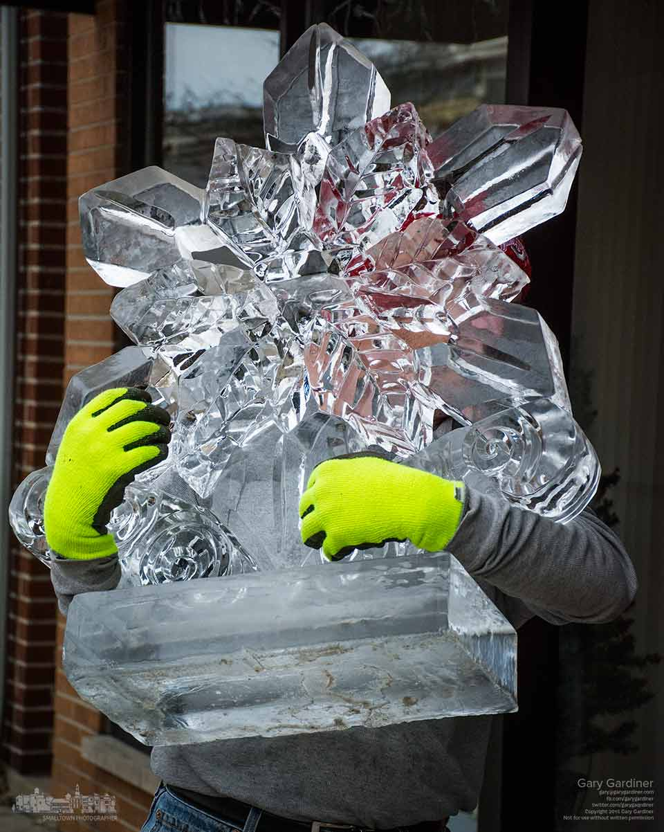 One of 12 ice sculptures is carried into place in Uptown Westerville as part of the communities last weekend celebration before Christmas. My Final Photo for Dec. 18, 2015.