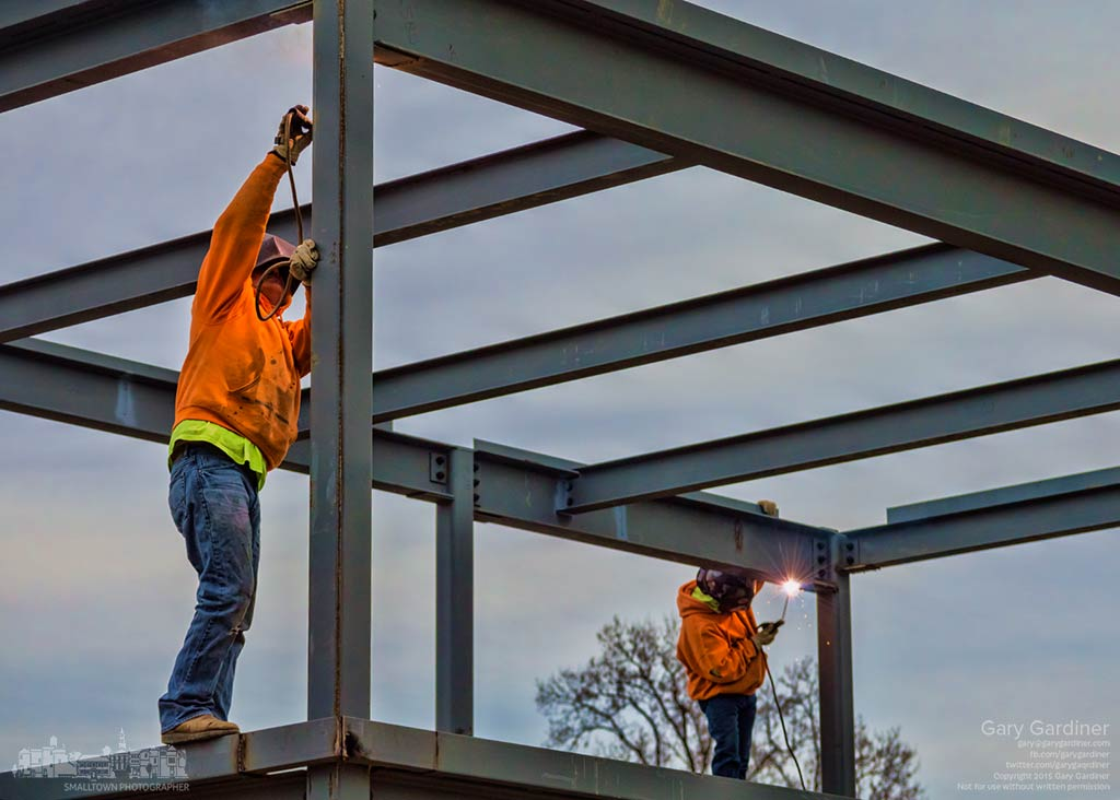 A pair of steelworkers weld joints on the superstructure for the Northstar Cafe on South State St. trying to complete the steel structure after unexpected construction delays. My Final Photo for Dec. 20, 2015.