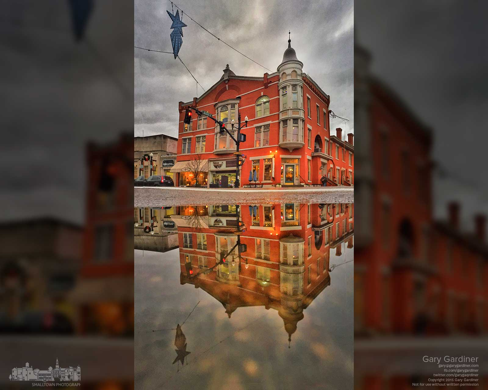 The Holmes Hotel at State and Main is reflected in a small puddle of water after sunset and a day of rain. My Final Photo for Dec. 1, 2015.