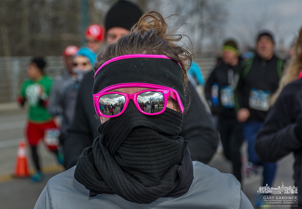 A runner in the First on the First 5k wraps herself in a warm scarf and pink sunglasses as she braves the 20 degree temperatures on the first 5k of the year in Westerville. My Final Photo for January 1, 2016.
