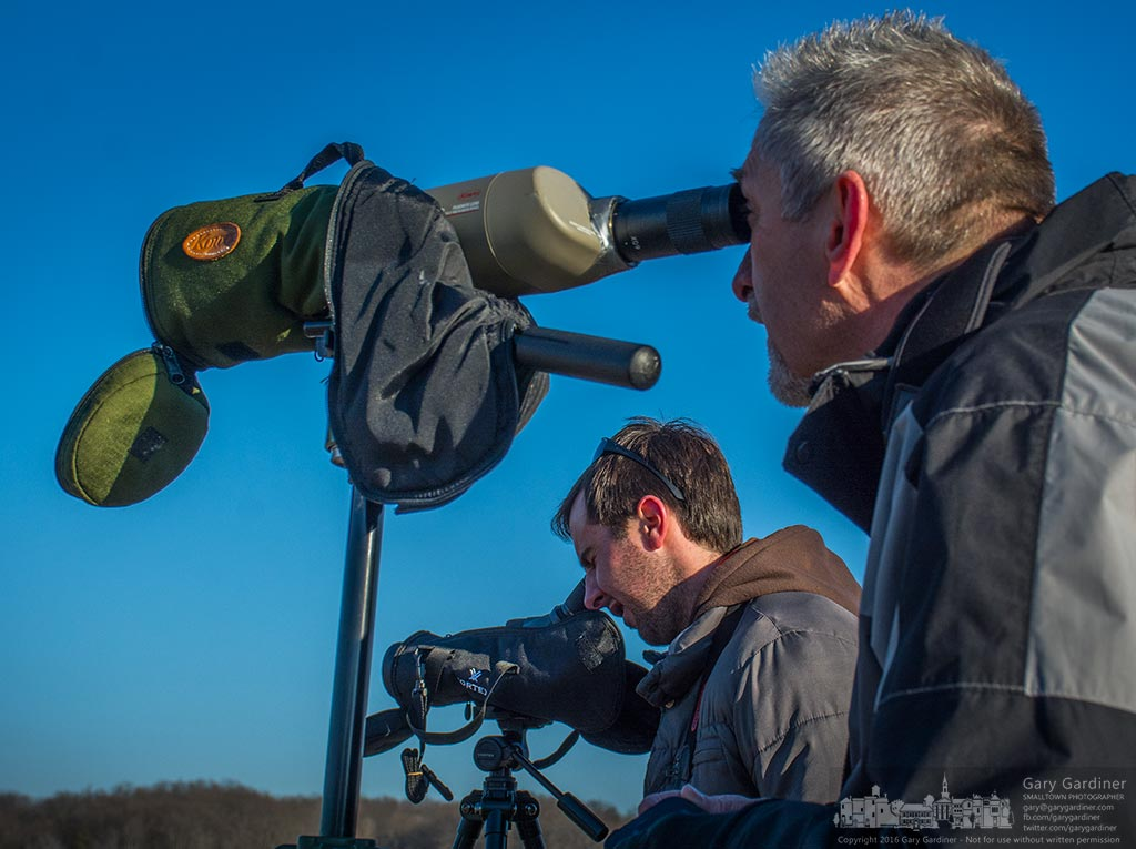 A pair of birders watch a flock of gulls on Hoover Reservoir trying to determine the variety of a rarely seen gull on Hoover. My Final Photo for January 29, 2016.