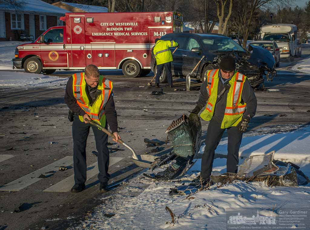 Fire fighters clean up debris from a two-cart non-injury accident at Spring and Schrock that left two cars disabled and carload of kids taken to school in a third vehicle. My Final Photo for January 13, 2016.