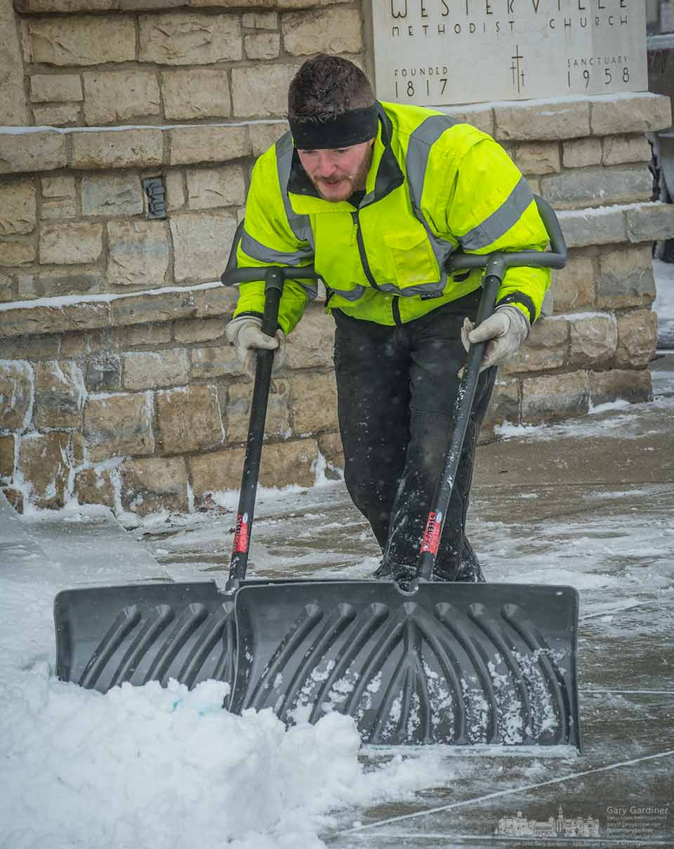 Using two hands, two arms, and two shovels this hard worker clears the snow on the main steps in front of church of the Messiah in Uptown Westerville. My Final Photo for January 12, 2016.