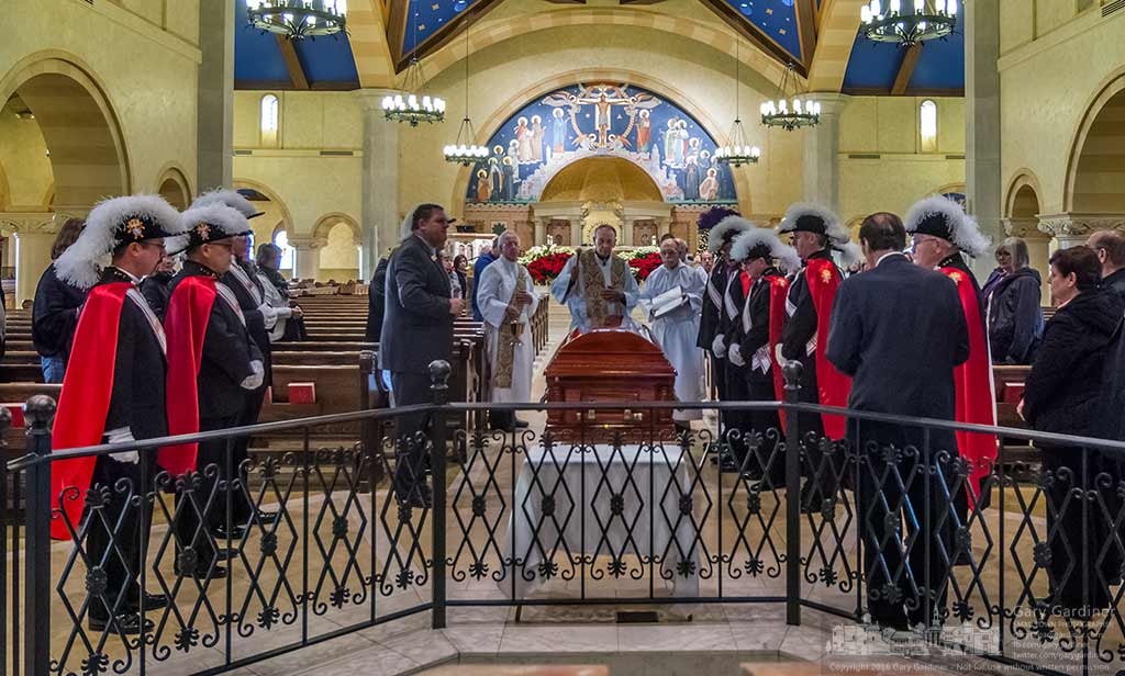 St. Paul pastor Fr. Charles Klinger begins ceremonies as Fr. Raymond Lavelle's casket processes into the church for his funeral. My Final Photo for January 5, 2016.