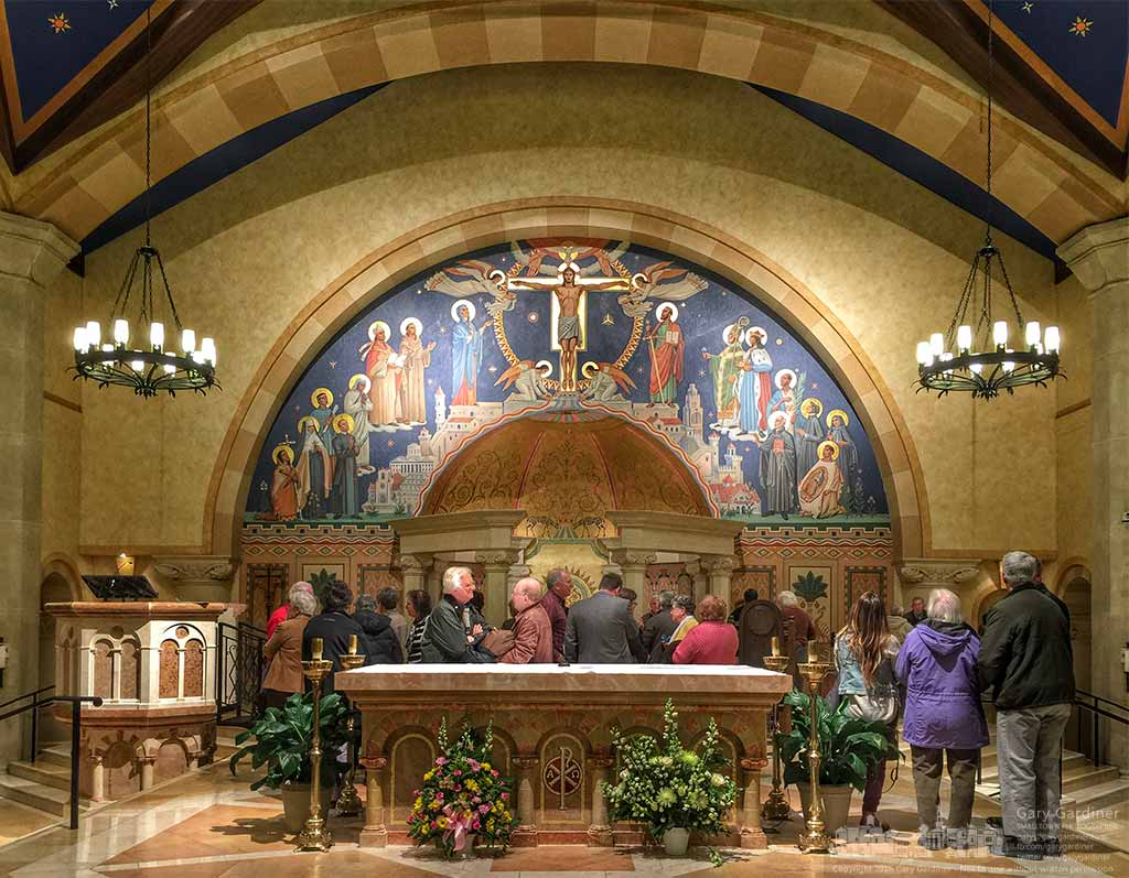 Members of the Westerville Historical Society stand at the altar and tabernacle at St. Paul the Apostle Catholic Church at the end of their meeting after learning about the church's history and hearing a brief recital of the pipe organ's music. My Final Photo for January 22, 2016.
