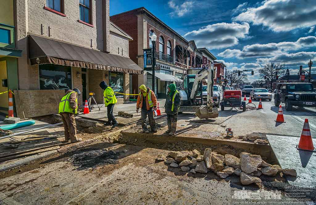 A work crew and city inspectors work to repair a sewer line from 18 North State Street in Uptown Westerville that required them to tear up a portion of the street to make the proper connections to an existing sewer pipe. My Final Photo for January 19, 2016.