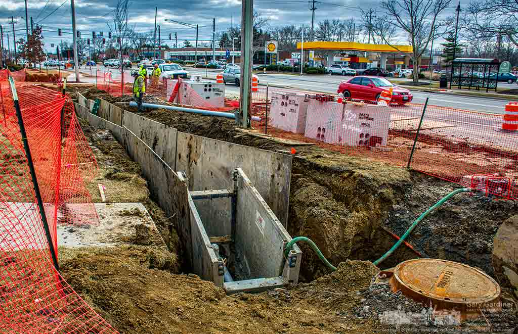 Contractors lay underground utility pipes beside State Street as construction continues to rebuild the intersection with Schrock Road. My Final Photo for February 26, 2016.