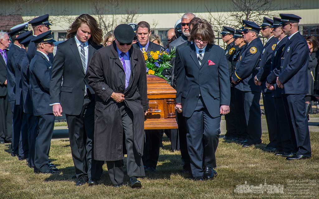 Family and friends of Reynoldsburg police officer Ty Downard carry his casket past other officers during funeral services for Downard at Blendon Cemetery. My Final Photo for February 27, 2016.