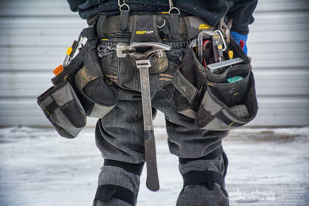 A construction worker's tool belt hangs heavy on his hips near the end of a day raising the roof on a pole barn for a customer. My Final Photo for February 9, 2016.