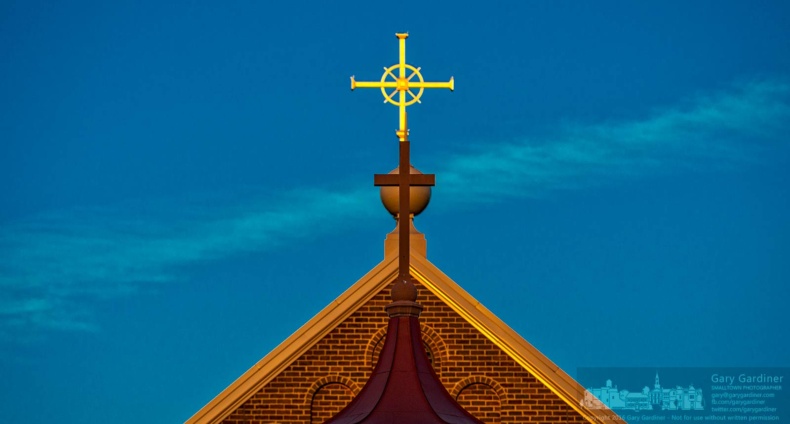 The rising sun slowly brightens the cross at the top of St. Paul Catholic Church. My Final Photo for February 28, 2016.
