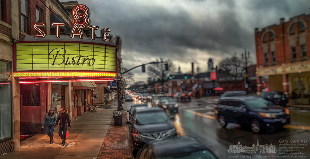 A couple walks beneath the bright and recently restored marquee marking 8 State Bistro as the newest occupant of the old State Theater in Uptown Westerville. My Final Photo for March 1, 2016.