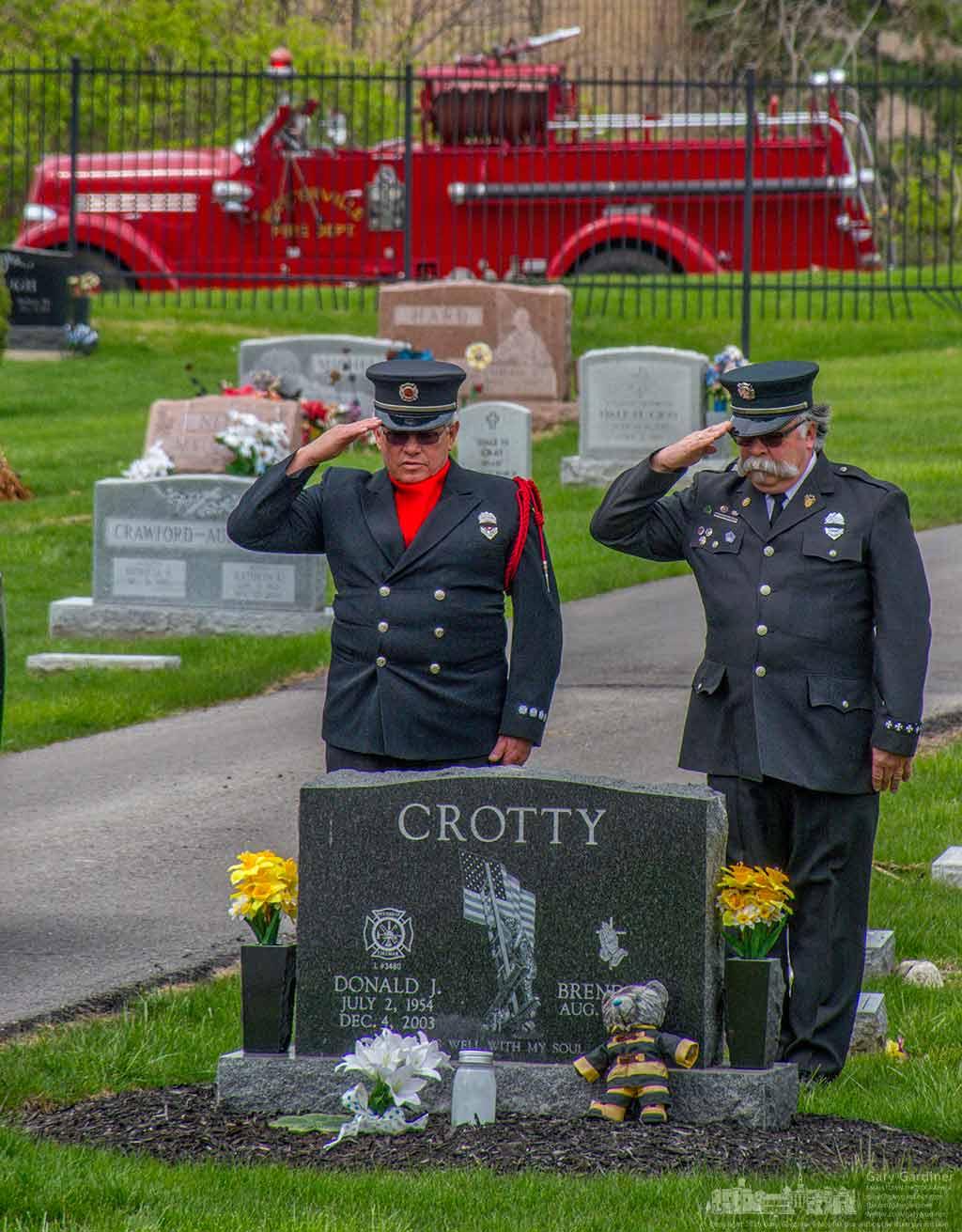 Retired fire fighters Bruce Barber, left, and Tom Ullom salute as they stand at the grave site of a Westerville firefighter who died in 2003. The two were part of an honor guard for another fire fighter buried Wednesday. My Final Photo for April 6, 2016