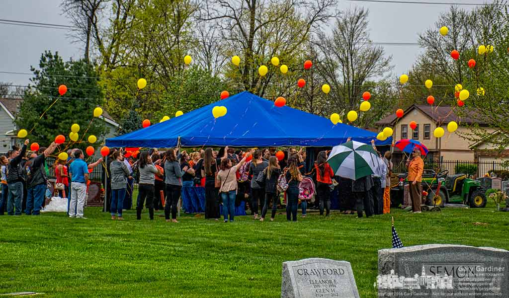 Family and friends release balloons after funeral services in Blendon Cemetery Thursday. My Final Photo for April 21, 2016.