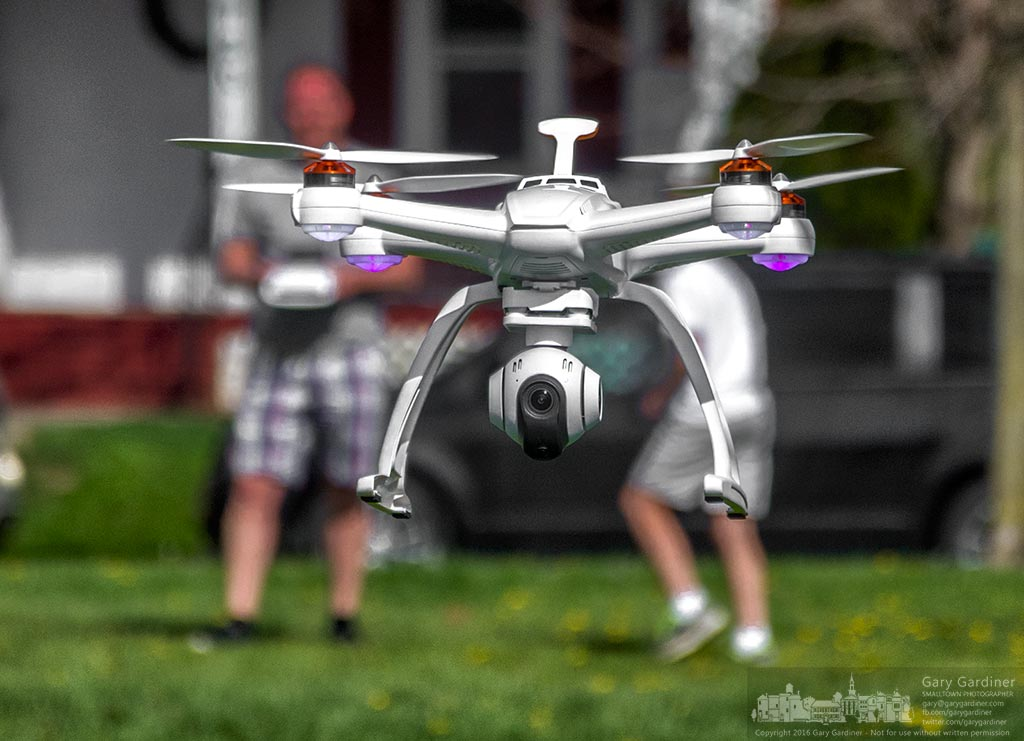 A father and son test their skills operating a new drone over the field at Presidents Park along the Ohio-Erie bike trail. My Final Photo for April 20, 2016.